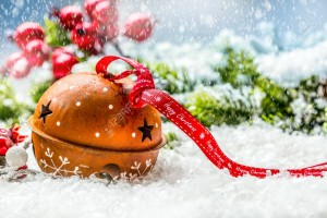 Christmas balls jingle bells. Red ribbon with text Happy Christmas. Snowy abstract background and decoration